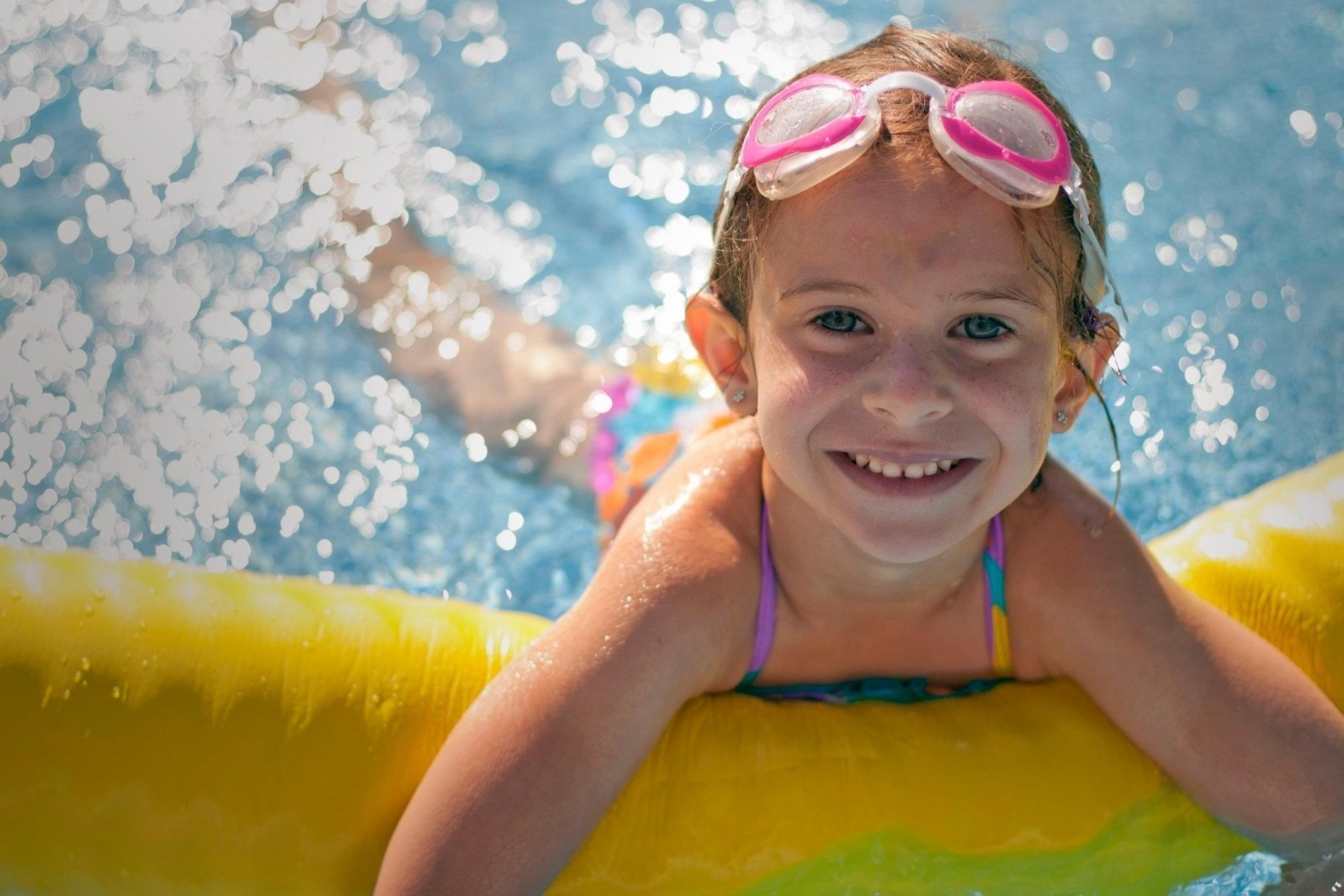 portrait-of-girl-smiling-and-swimming-in-pool.jpg